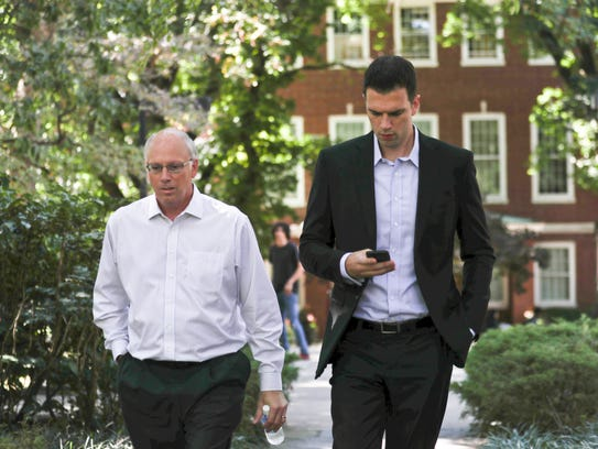 David Padgett walks from the Office of the President