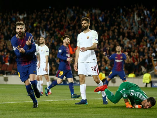 Barcelona's Gerard Pique, left. celebrates after scoring the third goal of his team during a Champions League quarter-final, first leg soccer match between FC Barcelona and Roma at the Camp Nou stadium in Barcelona, Spain, Wednesday, April 4, 2018.(AP Photo/ Manu Fernandez)