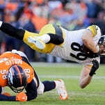 Pittsburgh Steelers tight end Matt Spaeth, top, flies over Denver Broncos outside linebacker Von Miller during the first half in an NFL football divisional playoff game, Sunday, Jan. 17, 2016, in Denver. (AP Photo/Joe Mahoney)
