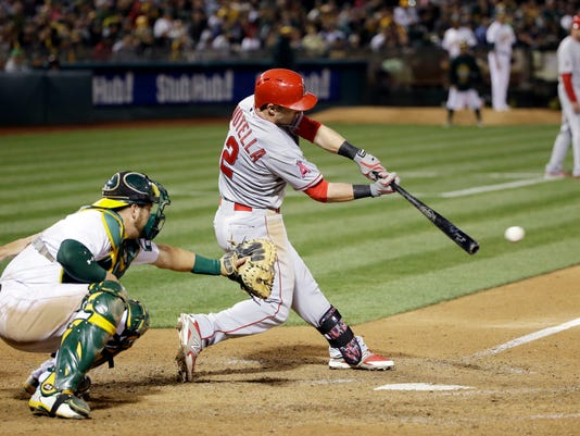 Los Angeles Angels' Johnny Giavotella drives in a run with a single against the Oakland Athletics during the seventh inning of a baseball game Wednesday, April 29, 2015, in Oakland, Calif. (AP Photo/Marcio Jose Sanchez)