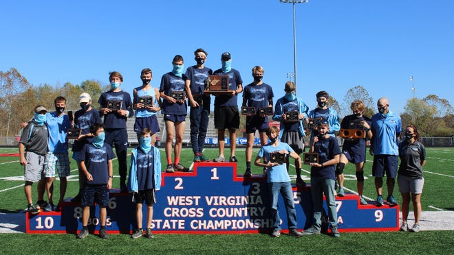 The entire Frankfort boys' cross country team poses as the West Virginia class AA state champions. Tribune photo by Chapin Jewell