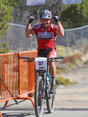 Brent Winebarger celebrates after crossing the finish