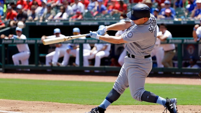 Seattle Mariners' Kyle Seager follows through on a run-scoring double off a pitch from Texas Rangers' Yu Darvish during the first inning of a baseball game, Sunday, June 18, 2017, in Arlington, Texas. (AP Photo/Tony Gutierrez)