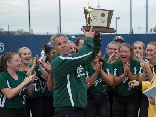 South Plainfield Coach Don Panzarella holds up their