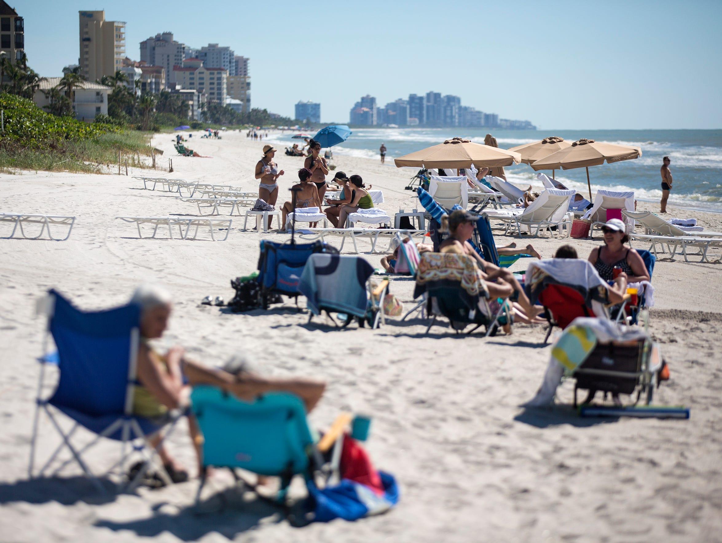 Beachgoers enjoy the public Bluebill Beach Access point