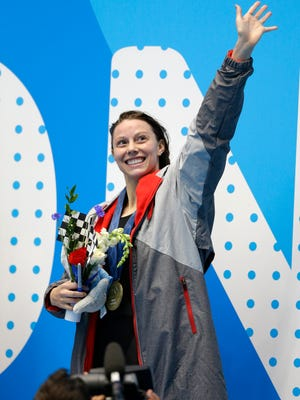 Hali Flickinger waves after winning the women's 200-meter butterfly at the U.S. swimming national championships in Indianapolis, Tuesday, June 27, 2017. (AP Photo/Michael Conroy)