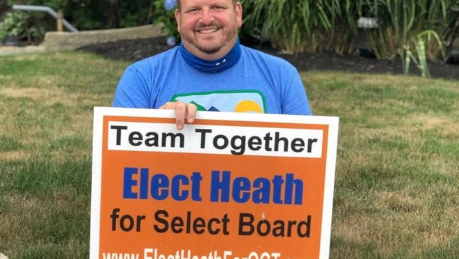 Heath Ouellette was reelected to the Ogunquit Select Board on July 14, 2020. He spent the day on a private lawn across the street from the town's polling place, holding a campaign sign and speaking with voters.