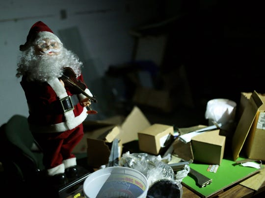 A dancing Santa Claus and other Christmas decorations