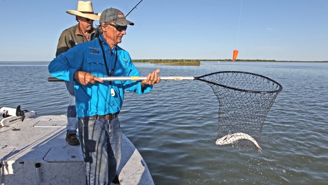 Robert Hamilton nets another fish for Hermann Brune north of Rockport.