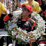 Juan Pablo Montoya, of Colombia, celebrates after winning the 99th running of the Indianapolis 500 auto race at Indianapolis Motor Speedway in Indianapolis Sunday.