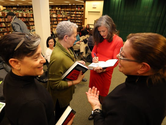 Amy Siskind of Mamaroneck signs copies of her book