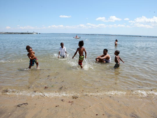Beach-goers cool off in the water at Playland beach, June 27, 2014 in Rye.