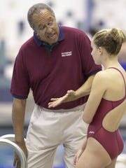 Marty Keating, shown in a 2002 file photo, started coaching the Pittsford girls swimming and diving team in 1974.