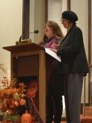 The Rev. Bridget Flad Daniels, left, and Rabbi Shaina Bacharach give a blessing during the annual interfaith Thanksgiving worship service at St. Mary of the Angels Parish in Green Bay on Tuesday, Nov. 24, 2015. Flad Daniels is the senior pastor at Union Congregational United Church of Christ in Green Bay, and Bacharach leads Congregation Cnesses Israel in the city.
