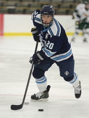 Bay Port's Martin Suda warms up before the FRCC game against Ashwaubenon at the Cornerstone Community Center on Friday.