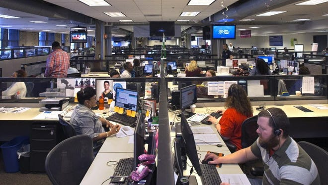 Workers respond to customer calls at the Time Warner Cable call center in Milwaukee. Charter Communications, which bought Time Warner, now has about 90 percent of the traditional cable business in the state.