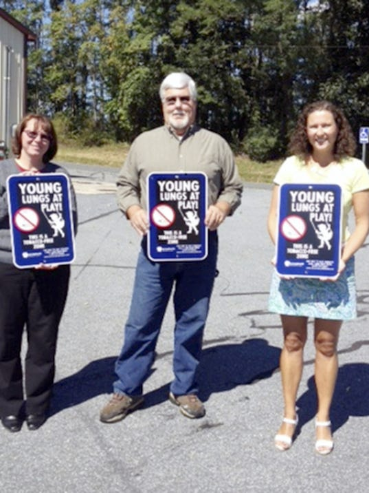 Lebanon Family Health Services recently welcomed Swatara Township to the growing list of Lebanon County communities who have joined Young Lungs at Play, an initiative to make public parks, playing fields and playgrounds tobacco-free. Pictured holding Young Lungs at Play posters are, from left, Jennifer Harding and Joseph Gregory of Swatara Township, and Holly Dolan of Lebanon Family Health Services.
