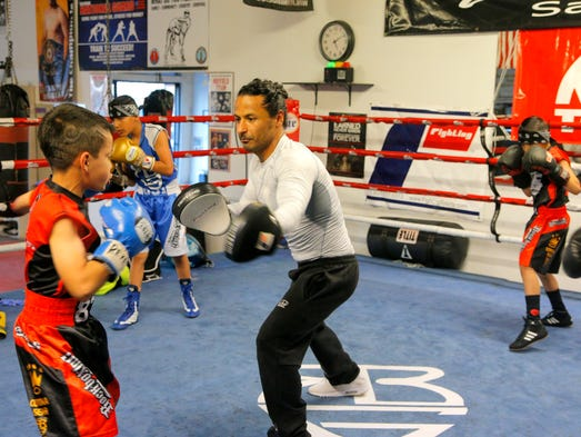 Rock Boxing Coach Danny Corona spars with young boxers