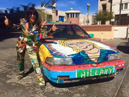 A Hillary Clinton supporter poses in El Paso during