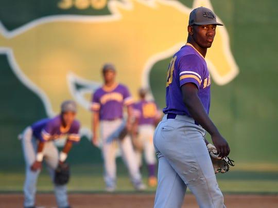 Hattiesburg High pitcher Dexter Jordan prepares to
