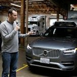 Uber threatens to fire key exec in self-driving car dispute