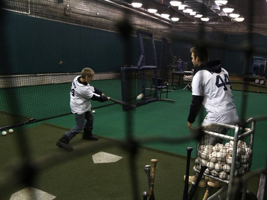 Hunter Bowman hits a line drive in the Tigers batting cage from an underhanded pitch thrown to him by his new friend, Tigers pitcher Daniel Norris, on Feb. 13.