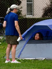 Kelly Vogt, right, from Delaware, talks with Peg Watkins, from Delaware, from her tent Thursday, June 21, 2018, at the Fairfield County Fairgrounds in Lancaster. Vogt and Watkins were participating in the Great Ohio Bicycle Adventure. Participants in the ride spent Wednesday and Thursday night camping at the fairgrounds.