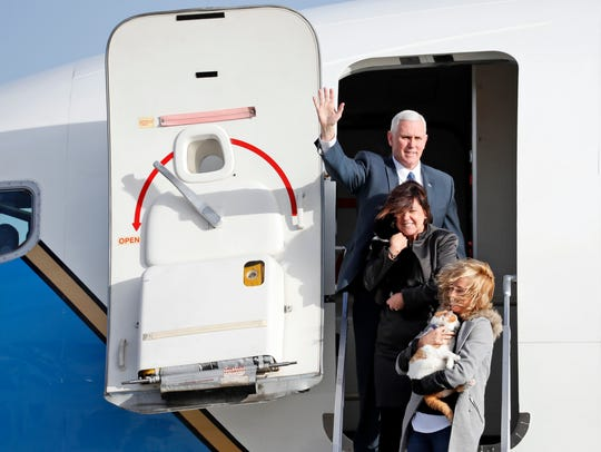 Pence steps off an Air Force plane similar to the one