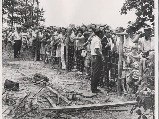 A fence blocked the hundreds who passed by the wreckage