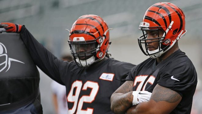 The Bengals had a tough roster decision to make at defensive line. Pat Sims (left) made the team while Devon Still (right) did not.