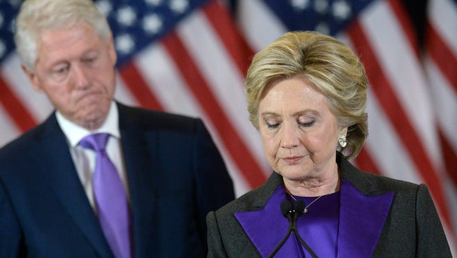 Hillary Clinton delivers her concession speech in New York on Nov. 9, 2016, as her husband, former president Bill Clinton, looks on.