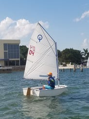 Shae Riley gives the thumbs-up while sailing on the