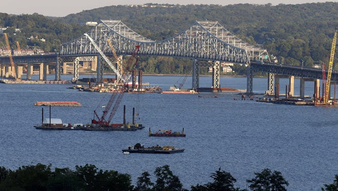 Construction equipment is positioned near the Tappan Zee Bridge as seen from Nyack, N.Y. With a price tag of $3.9 billion, the new Tappan Zee Bridge is one of the most expensive public works projects in U.S. history.
