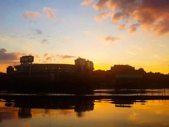 An orange sunset over Neyland Stadium on Sunday, June