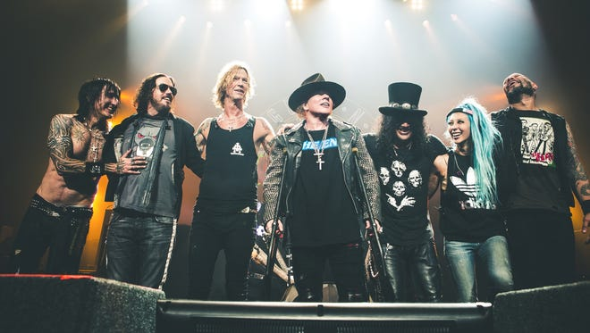 The reunited Guns N' Roses with (center three) Duff McKagan, Axl Rose and Slash.