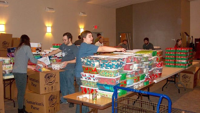 Volunteers packing boxes for Operation Christmas Child. Local families and churches are invited to pack boxes, which are send to children in need around the world.