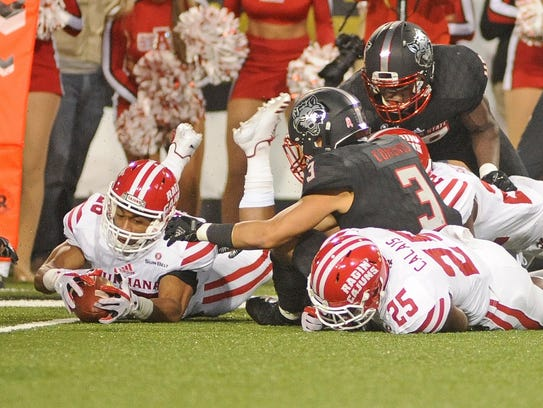 UL wide receiver Chris Collins recovers a fumble during