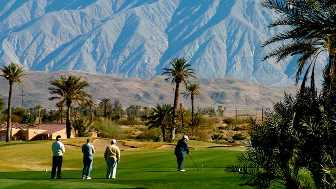 This undated photo provided by San Diego Tourism shows golfers at Borrego Springs Resort Golf Course in the San Diego County desert.