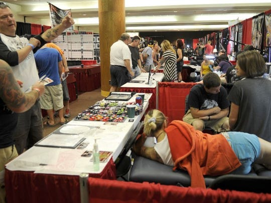 Approximately 100 artists from around the country were on hand to sell their artwork and tattoo guests at the 2012 Knoxville Tattoo Convention at the Holiday Inn World's Fair Park. The event returns this weekend.