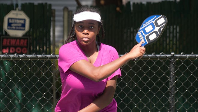 Ebony Johnson, 13,  plays Pickleball  during a game at the Lion's Den Courts in Cherry Hill.