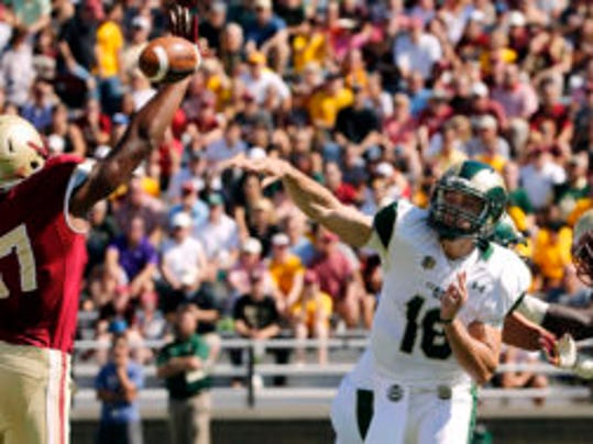 Sep 27, 2014; Boston, MA, USA; Colorado State Rams quarterback Garrett Grayson (18) throws over Boston College Eagles defensive end Malachi Moore (87) during the first half at Alumni Stadium. Mandatory Credit: Winslow Townson-USA TODAY Sports