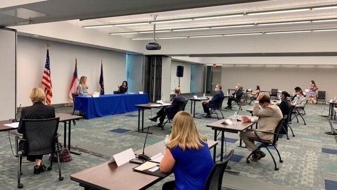 U.S. Sen. Kelly Loeffler, R-Ga., and CMS Administrator Seema Verma (top left) talk COVID-19 concerns with Georgia health-care and nursing home leaders in Atlanta on July 27, 2020