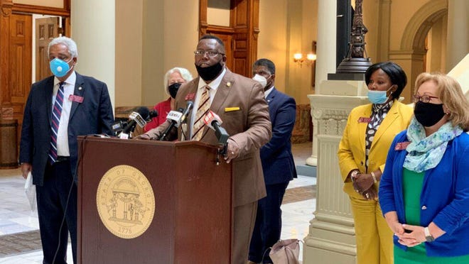 Rep. Carl Gilliard (D-Savannah) talks about his bill to repeal Georgia's citizen's arrest law at the State Capitol on June 18, 2020.