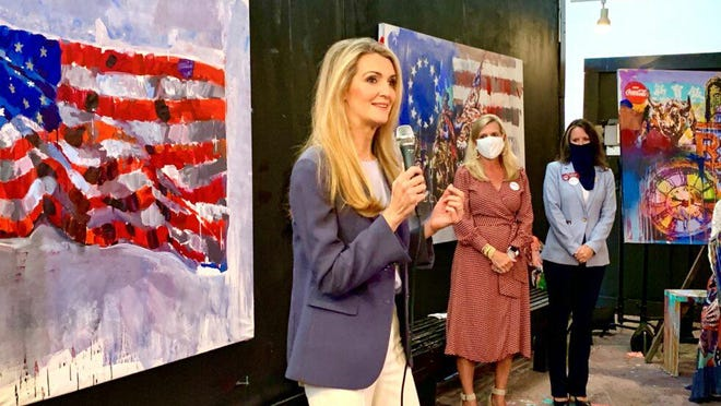 U.S. Sen. Kelly Loeffler (R-Ga.) speaks at a campaign stop with Georgia First Lady Marty Kemp (center) and state Rep. Jodi Lott (right) at the Penley Art Gallery in Buckhead on Aug. 18, 2020.