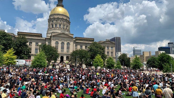 Thousands gathered outside the State Capitol to protest police brutality and racial injustice as lawmakers met for the 2020 legislative session on June 19, 2020.