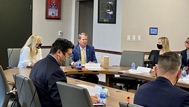 Gov. Brian Kemp speaks at a roundtable meeting on human trafficking in Atlanta on Sept. 30, 2020.