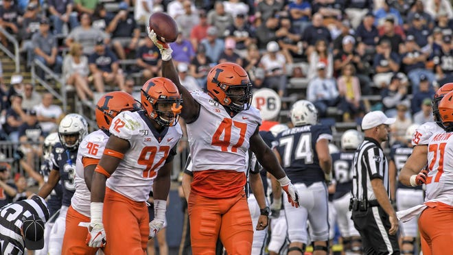 Illinois defensive end Oluwole Betiku Jr. celebrates a fumble recovery against Connecticut in the Illini's Sept. 7 victory in East Hartford, Conn.