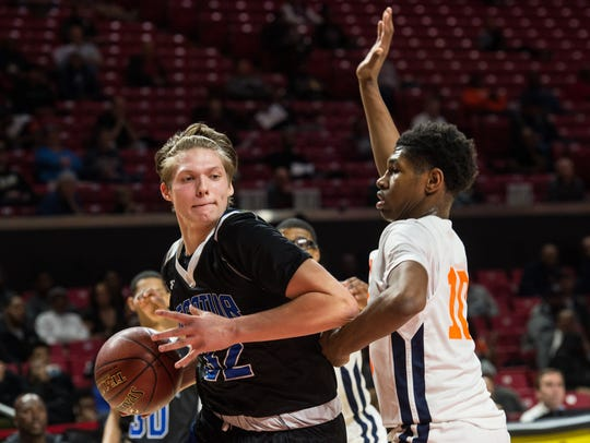 Decatur's Churchill Bounds (32) recovers a rebound