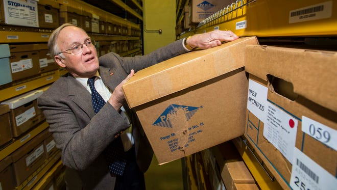 Former Governor Jim Douglas peruses some of the records from his time in office at the state archives in Middlesex on Friday, January 6, 2017.  Some of his records are being unsealed after six years.