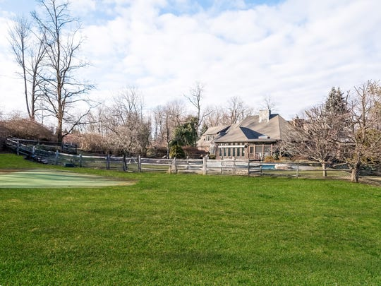 The home includes a pool and putting green.